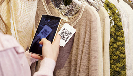 A customer scans the QR code of a product with his smartphone